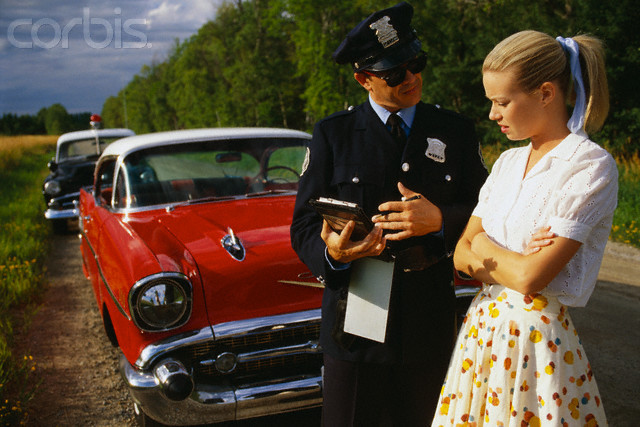 Police Officers Giving Woman Traffic Ticket